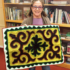 Jamie with felted rug from Kyrgystan